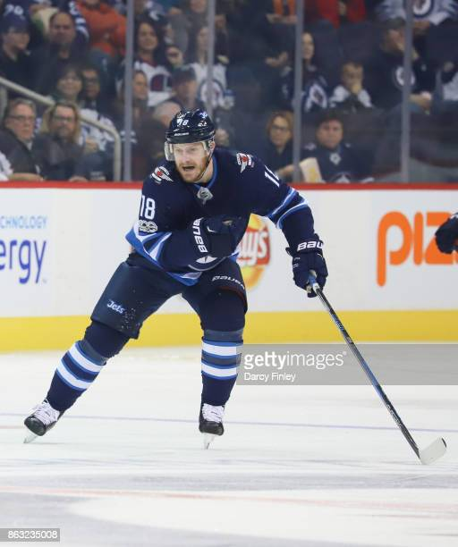 Bryan Little of the Winnipeg Jets follows the play down the ice during first period action against the Carolina Hurricanes at the Bell MTS Place on...