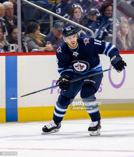 Bryan Little of the Winnipeg Jets follows the play down the ice during second period action against the Minnesota Wild at the Bell MTS Place on...