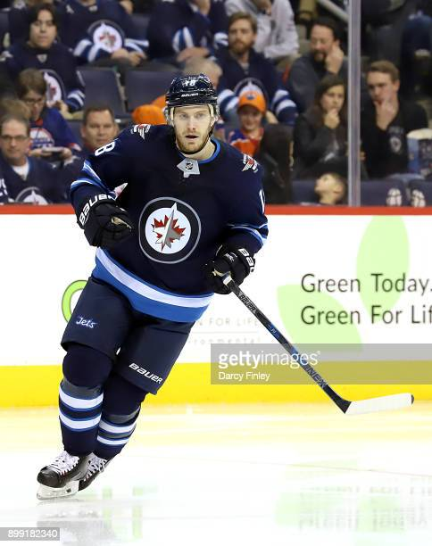 Bryan Little of the Winnipeg Jets follows the play down the ice during third period action against the Edmonton Oilers at the Bell MTS Place on...
