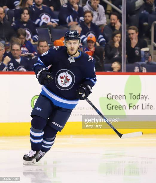 Bryan Little of the Winnipeg Jets follows the play up the ice during third period action against the Edmonton Oilers at the Bell MTS Place on...