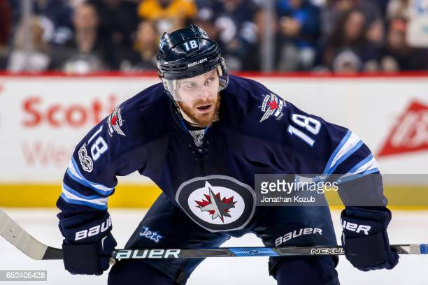 Bryan Little of the Winnipeg Jets gets set during a second period faceoff against the Pittsburgh Penguins at the MTS Centre on March 8 2017 in...