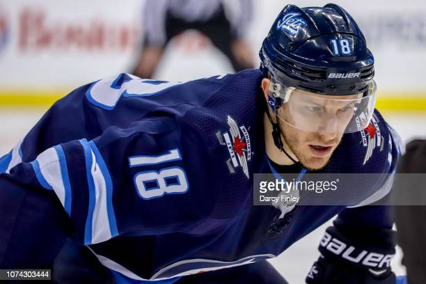 Bryan Little of the Winnipeg Jets gets set for a first period faceoff against the Tampa Bay Lightning at the Bell MTS Place on December 16 2018 in...
