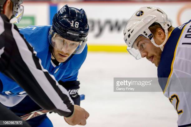 Bryan Little of the Winnipeg Jets gets set to take a first period faceoff against Johan Larsson of the Buffalo Sabres at the Bell MTS Place on...