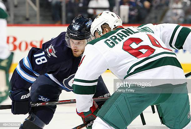 Bryan Little of the Winnipeg Jets gets set to take a first period faceoff against Mikael Granlund of the Minnesota Wild at the MTS Centre on October...