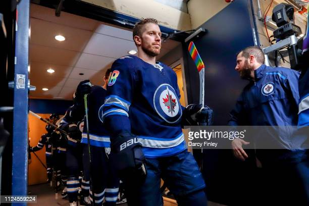 Bryan Little of the Winnipeg Jets heads to the ice sporting a rainbow coloured jersey as well as rainbow coloured stick tape in support of the Hockey...