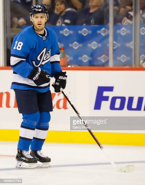 Bryan Little of the Winnipeg Jets keeps an eye on the play during first period action against the Arizona Coyotes at the Bell MTS Place on October 20...