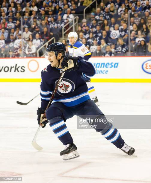 Bryan Little of the Winnipeg Jets keeps an eye on the play during third period action against the St Louis Blues at the Bell MTS Place on October 22...