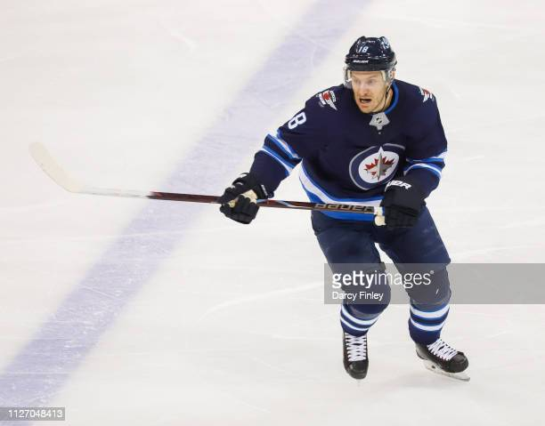 Bryan Little of the Winnipeg Jets keeps an eye on the play during second period action against the Columbus Blue Jackets at the Bell MTS Place on...