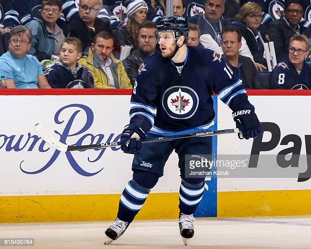 Bryan Little of the Winnipeg Jets keeps an eye on the play during first period action against the Carolina Hurricanes at the MTS Centre on October 13...