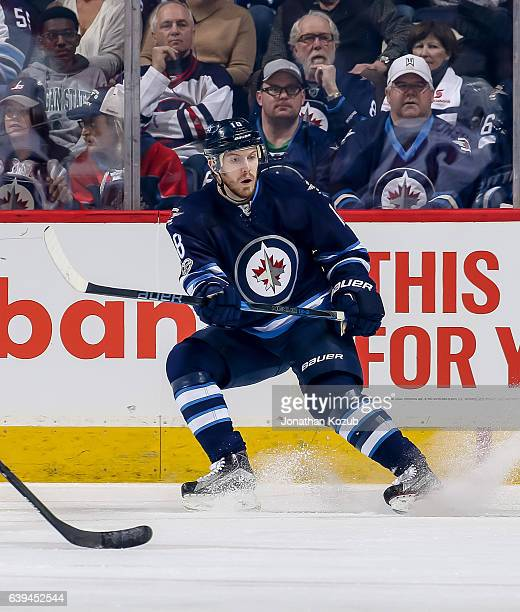 Bryan Little of the Winnipeg Jets keeps an eye on the play during first period action against the Arizona Coyotes at the MTS Centre on January 18...