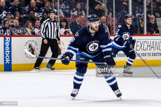 Bryan Little of the Winnipeg Jets keeps an eye on the play during third period action against the St Louis Blues at the MTS Centre on March 3 2017 in...