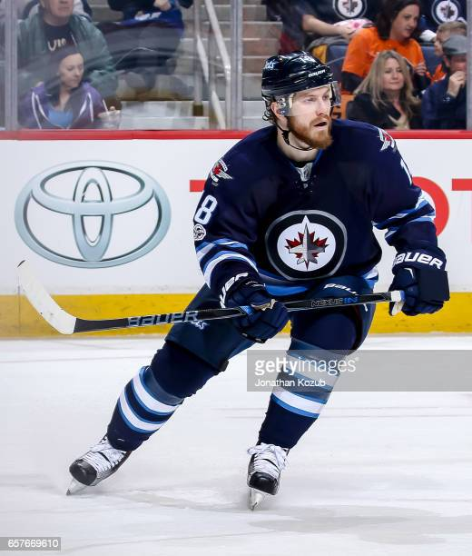 Bryan Little of the Winnipeg Jets keeps an eye on the play during second period action against the Philadelphia Flyers at the MTS Centre on March 21...