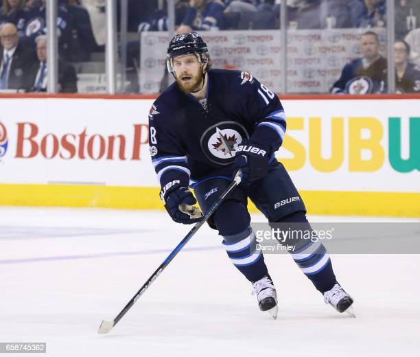 Bryan Little of the Winnipeg Jets keeps an eye on the play during first period action against the Vancouver Canucks at the MTS Centre on March 26...