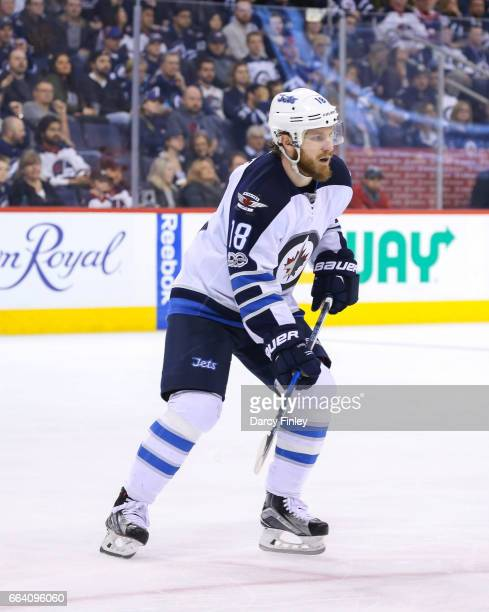 Bryan Little of the Winnipeg Jets keeps an eye on the play during third period action against the Anaheim Ducks at the MTS Centre on March 30 2017 in...