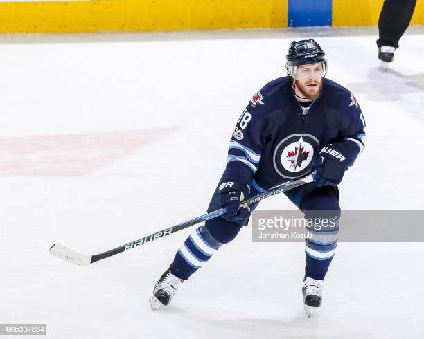 Bryan Little of the Winnipeg Jets keeps an eye on the play during second period action against the Ottawa Senators at the MTS Centre on April 1 2017...