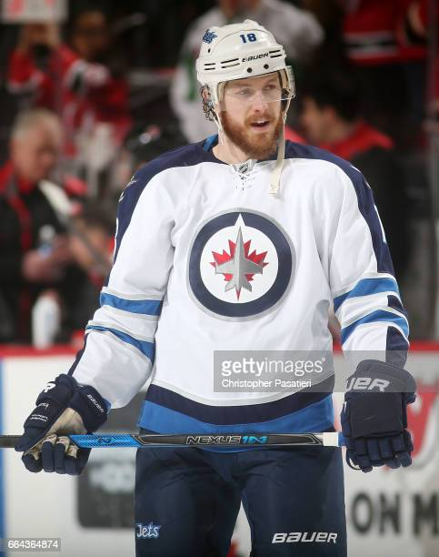Bryan Little of the Winnipeg Jets looks on during warm ups prior to the game against the New Jersey Devils on March 28 2017 at the Prudential Center...