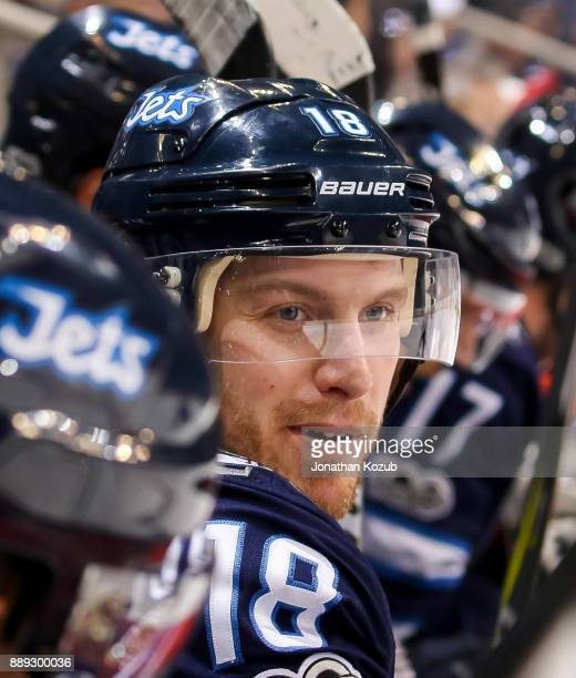 Bryan Little of the Winnipeg Jets looks on from the bench during third period action against the Ottawa Senators at the Bell MTS Place on December 3...