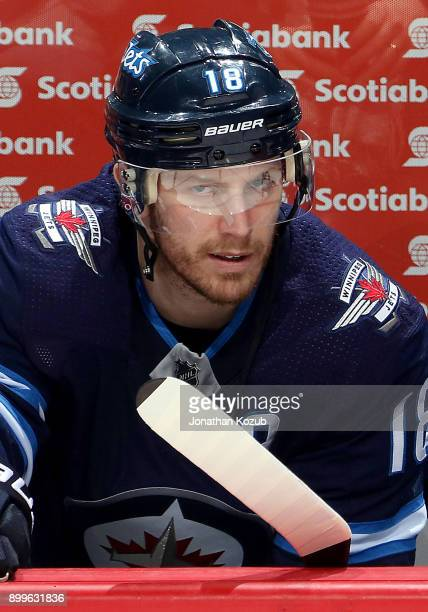 Bryan Little of the Winnipeg Jets looks on from the bench prior to puck drop against the New York Islanders at the Bell MTS Place on December 29 2017...