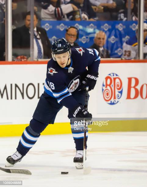 Bryan Little of the Winnipeg Jets plays the puck down the ice during second period action against the St Louis Blues at the Bell MTS Place on October...