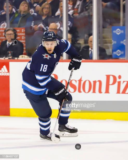 Bryan Little of the Winnipeg Jets plays the puck down the ice during first period action against the San Jose Sharks at the Bell MTS Place on March...