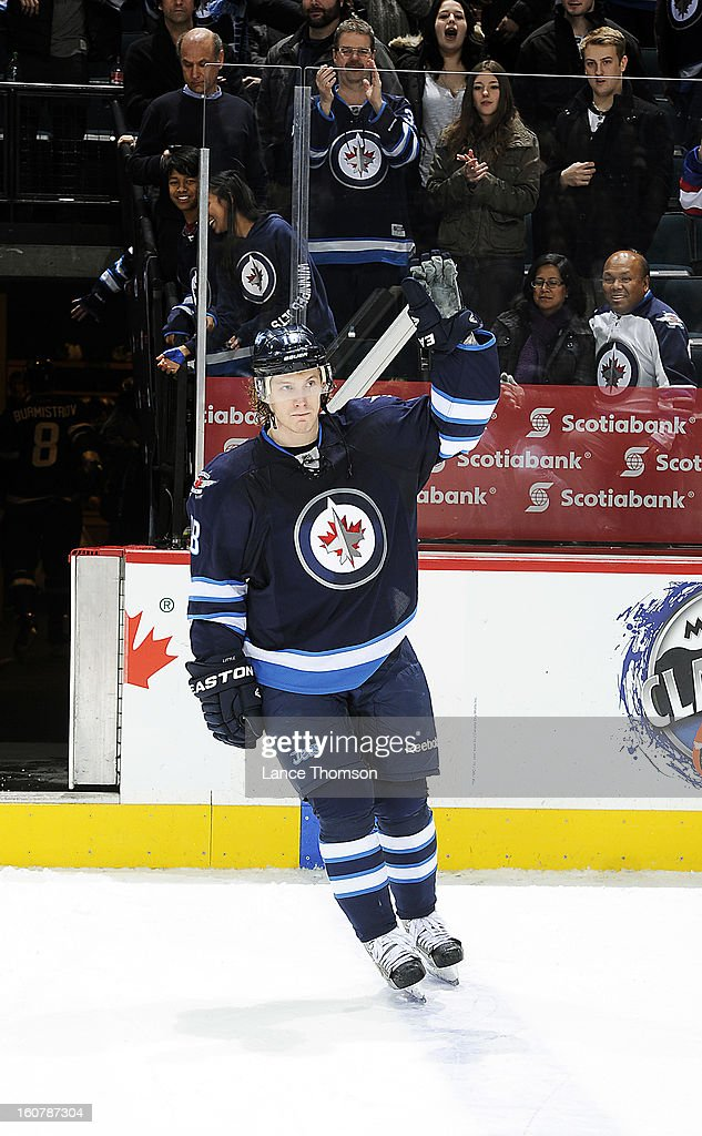 Bryan Little #18 of the Winnipeg Jets salutes the fans after being named the first star of the game following a 3-2 overtime victory over the Florida Panthers at the MTS Centre on February 5, 2013 in Winnipeg, Manitoba, Canada.