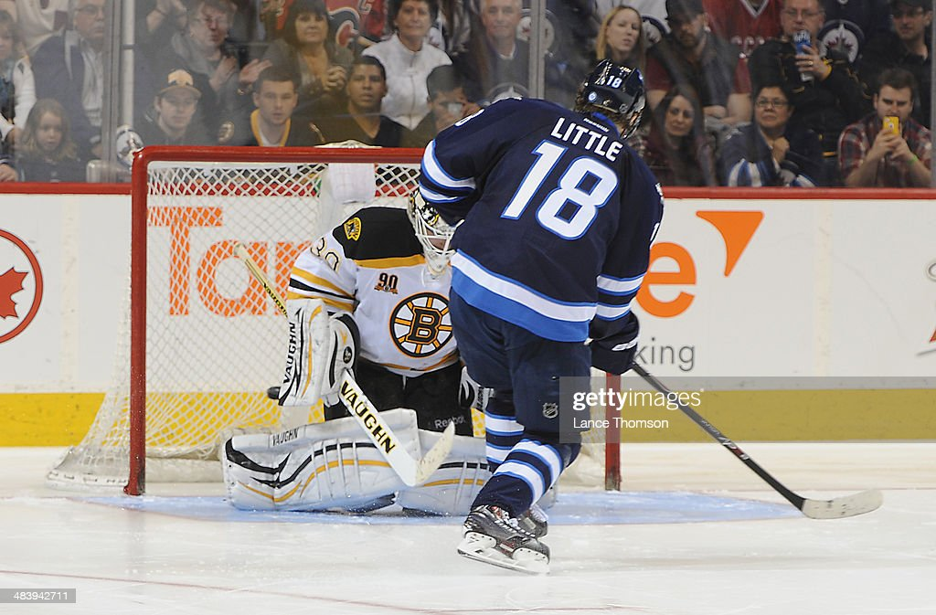 Bryan Little #18 of the Winnipeg Jets scores on goaltender Chad Johnson #30 of the Boston Bruins during the shootout at the MTS Centre on April 10, 2014 in Winnipeg, Manitoba, Canada.