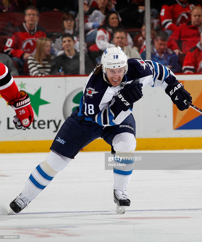 Bryan Little #18 of the Winnipeg Jets skates against the New Jersey Devils during the game at the Prudential Center on February 24, 2013 in Newark, New Jersey.