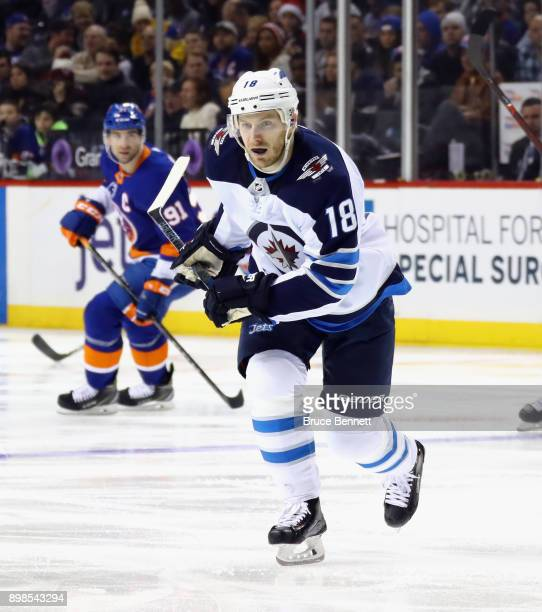 Bryan Little of the Winnipeg Jets skates against the New York Islanders at the Barclays Center on December 23 2017 in the Brooklyn borough of New...