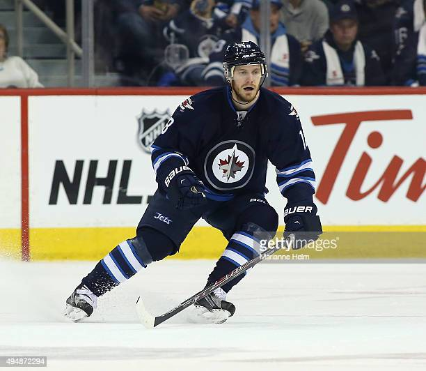 Bryan Little of the Winnipeg Jets skates down the ice during second period action in an NHL game against the Minnesota Wild at the MTS Centre on...