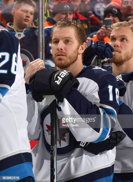 Bryan Little of the Winnipeg Jets stands for the singing of the national anthem prior to the game against the Edmonton Oilers on December 31 2017 at...