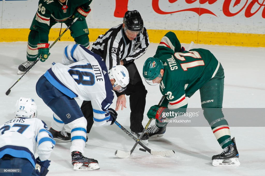 Bryan Little #18 of the Winnipeg Jets takes a face-off against Eric Staal #12 of the Minnesota Wild during the game at the Xcel Energy Center on January 13, 2018 in St. Paul, Minnesota.
