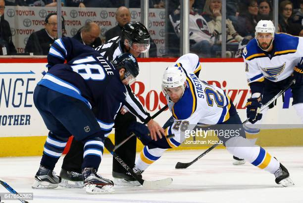 Bryan Little of the Winnipeg Jets takes a first period faceoff against Paul Stastny of the St Louis Blues at the MTS Centre on March 3 2017 in...
