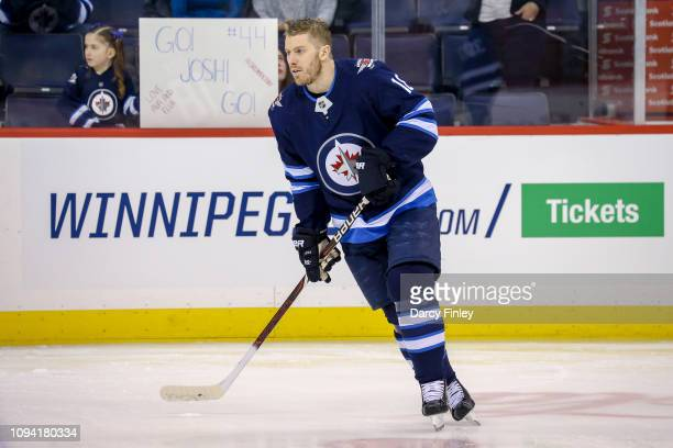 Bryan Little of the Winnipeg Jets takes part in the pregame warm up prior to NHL action against the San Jose Sharks at the Bell MTS Place on February...
