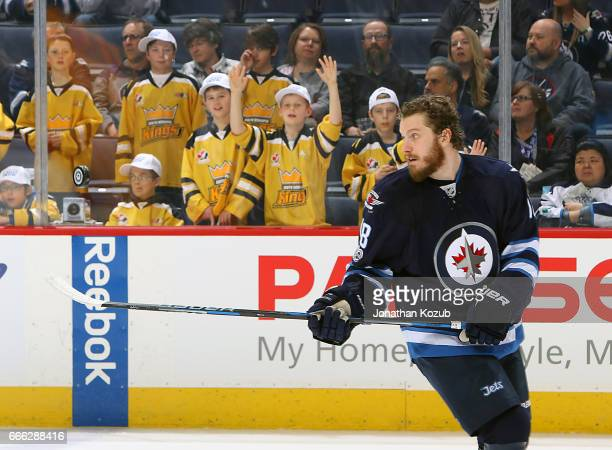 Bryan Little of the Winnipeg Jets takes part in the pregame warm up prior to NHL action against the Nashville Predators at the MTS Centre on April 8...