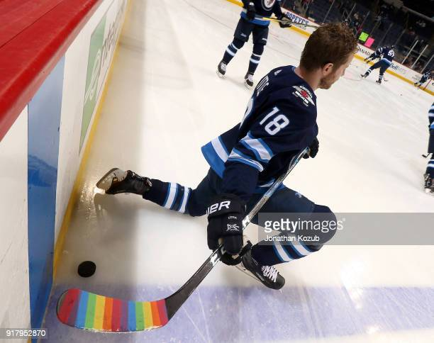 Bryan Little of the Winnipeg Jets takes part in the pregame warm up sporting rainbow tape for You Can Play Night in support of the Hockey Is For...