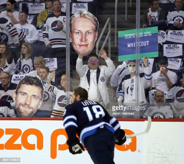 Bryan Little of the Winnipeg Jets warms up as fans show off signs prior to Game Six of the Western Conference Second Round during the 2018 NHL...