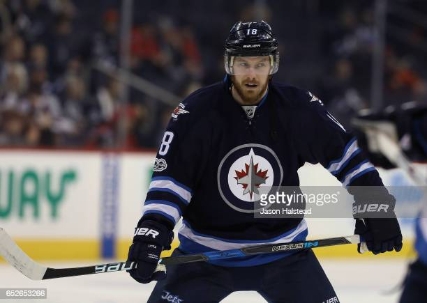 Bryan Little of the Winnipeg Jets warms up before taking on the Calgary Flames in NHL action on March 11 2017 at the MTS Centre in Winnipeg Manitoba
