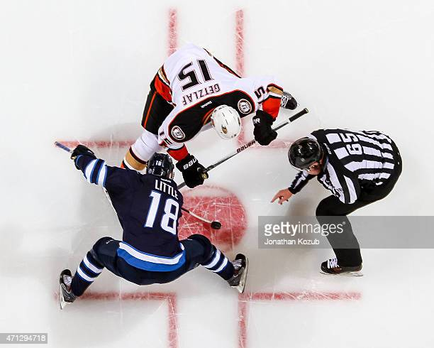Bryan Little of the Winnipeg Jets wins a second period faceoff against Ryan Getzlaf of the Anaheim Ducks in Game Three of the Western Conference...