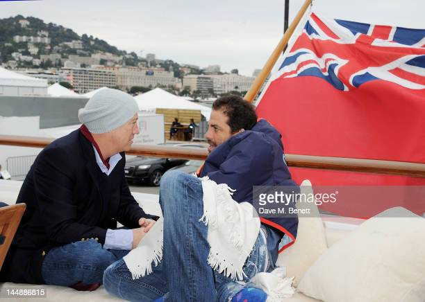 Bryan Lourd and Brett Ratner attend a lunch hosted by Len Blavatnik, Harvey Weinstein and Warner Music during the 65th Cannes Film Festival on board...