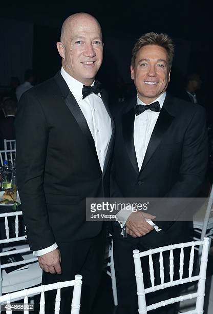 Bryan Lourd and Kevin Huvane of CAA attend amfAR's Inspiration Gala Los Angeles at Milk Studios on October 29 2015 in Hollywood California