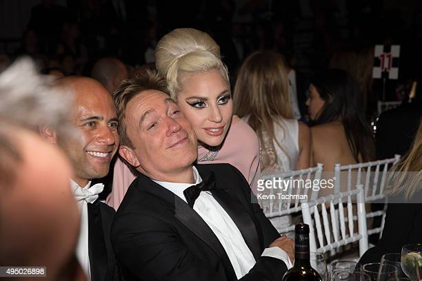 Bryan Lourd and Kevin Huvane of CAA pose for a photo with Lady Gaga at the amfAR Inspiration Gala at Milk Studios on October 29 2015 in Hollywood...