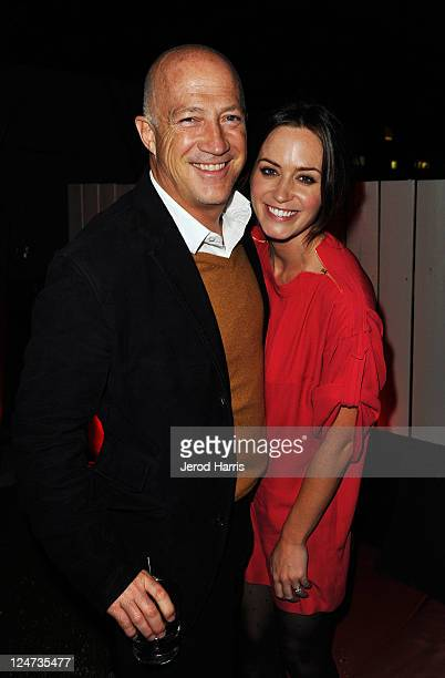 Bryan Lourd of CAA and Actress Emily Blunt at the smartwater CAA party on the vitaminwater Rooftop on September 11 2011 in Toronto Canada