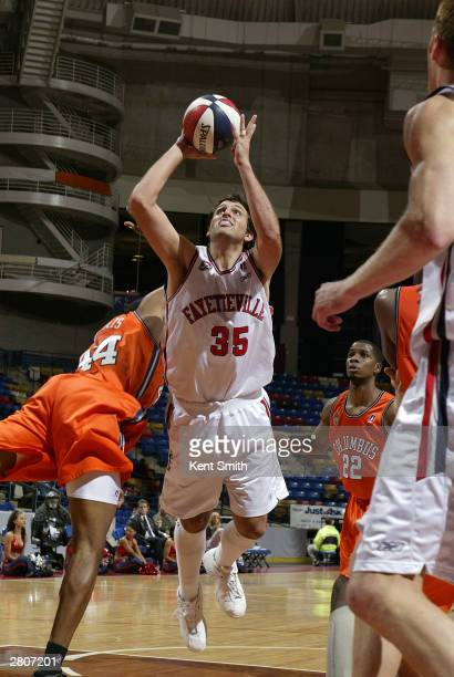 Bryan Lucas of the Fayetteville Patriots leans in for a shot against the Columbus Riverdragons December 12, 2003 at the Crown Coliseum in...