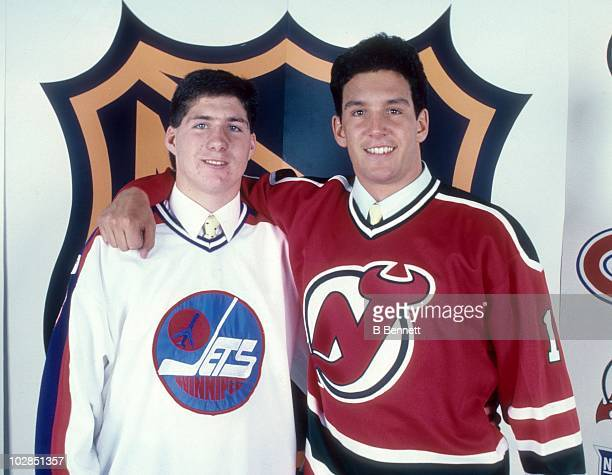Bryan Marchment selected sixteenth by the Winnipeg Jets and Brendan Shanahan selected second by the New Jersey Devils smile and wear their new...