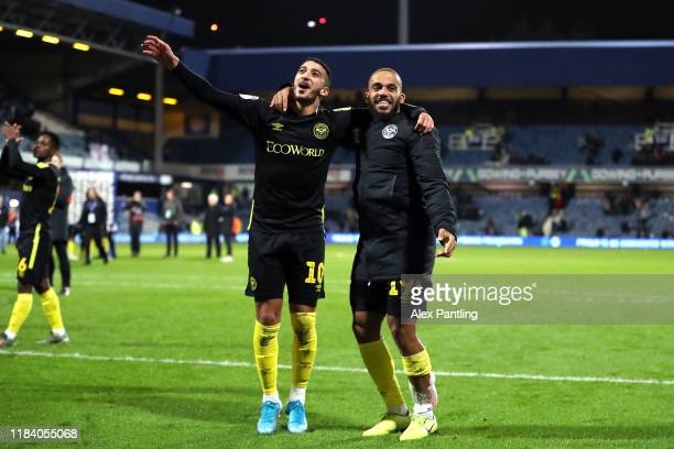 Bryan Mbeumo and Said Benrahma of Brentford celebrate victory during the Sky Bet Championship match between Queens Park Rangers and Brentford at The...