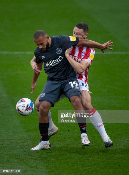 Bryan Mbeumo of Brentford and James Chester of Stoke City in action during the Sky Bet Championship match between Stoke City and Brentford at Bet365...