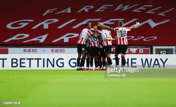 Bryan Mbeumo of Brentford celebrates with his team mates after he scores his team's third goal during the Sky Bet Championship Play Off Semifinal 2nd...