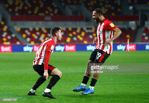 Bryan Mbeumo of Brentford celebrates with Sergi Canos after scoring their team's first goal during the Sky Bet Championship match between Brentford...