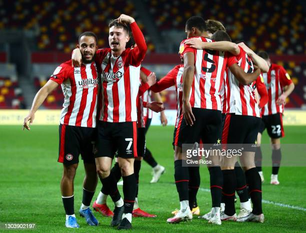 Bryan Mbeumo of Brentford celebrates with team mate Sergi Canos after scoring their side's first goal during the Sky Bet Championship match between...