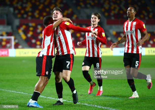 Bryan Mbeumo of Brentford celebrates with team mates Sergi Canos, Mathias Jensen and Ethan Pinnock after scoring their side's first goal during the...
